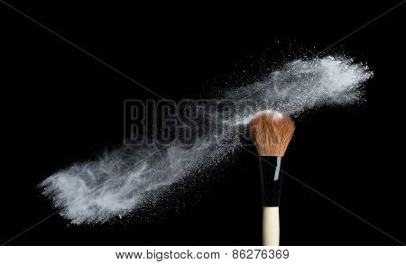 Make up brush with white powder  isolated on white