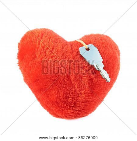 Key over a plush heart