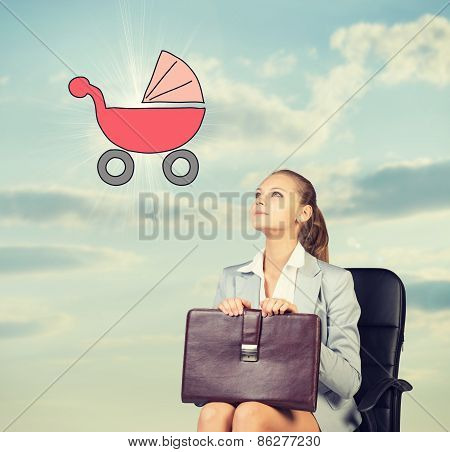 Business woman in skirt, blouse and jacket, sitting on chair imagines buggy. Against background of s