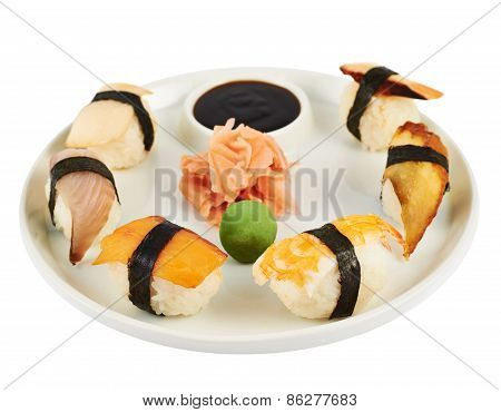 Sushi with soy sauce on a plate