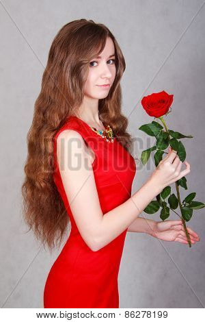 Beautiful Young Woman With A Red Rose