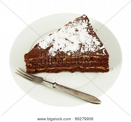 Piece of a chocolate cake in a plate