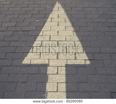 White Arrow Straight Sign On Street