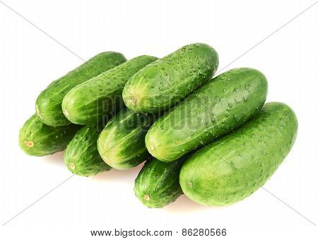 Pile of green cucumbers isolated