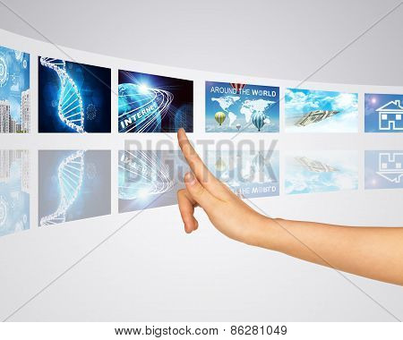 Communication, connection and transportation information. Finger presses one of virtual screens