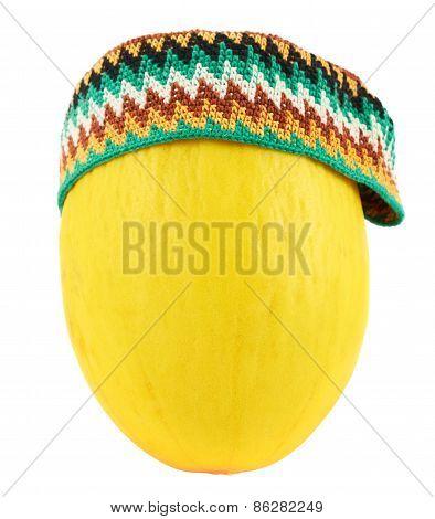 Colorful kofia hat over a melon
