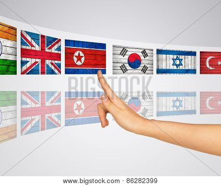 Theme flags various. Finger presses one of virtual screens