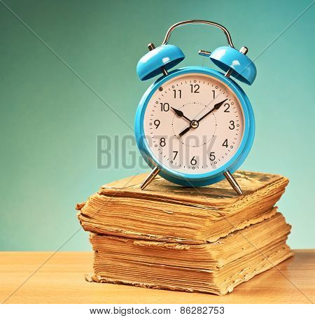 Alarm clock over the books
