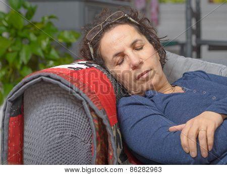 A Sick Woman Sleeping On A Sofa