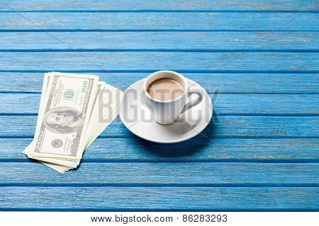 Cup Of Coffee And Hundred Dollars