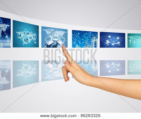 Information communication around world. Finger presses one of virtual screens