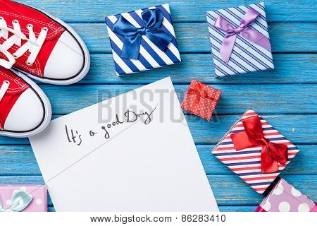 Paper With Inscription And Gifts With Gumshoes