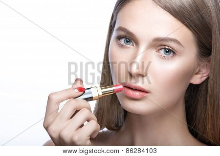 Charming young babe with lipstick and light makeup. Beauty face