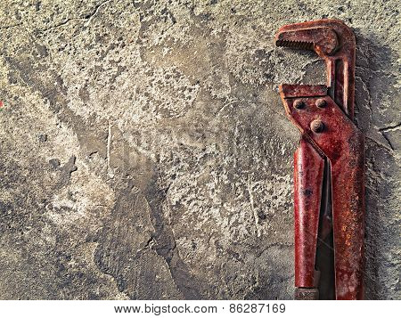 Old Wrench On Concrete