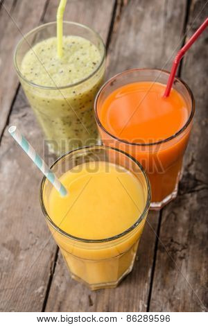 Three Smoothie on wooden background