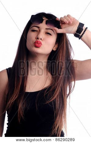 Pretty girl kissing raised glasses