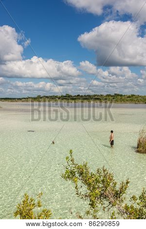 Beautiful Exploring Adventure At Tranquil Bacalar Lake. Riviera Maya, Mexico. Tropical Travel.