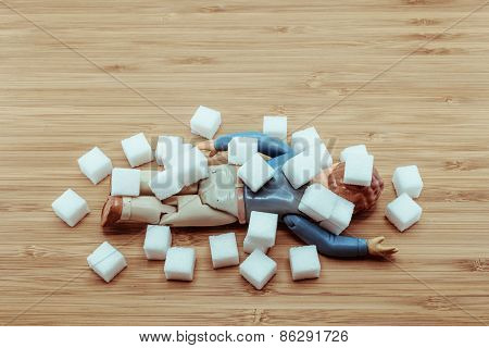 Drop Dead Doll Man Under Falling Sugar Cubes For The Concept Of High Blood Sugar