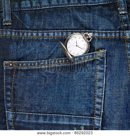 Pocket watch in a back pocket of a jeans