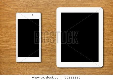 White Smartphone And Tablet Pc On The Table