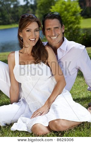Successful Happy Middle Aged Man And Woman Couple Sitting Outside