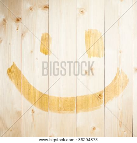 Simple happy face drawn over wood boards