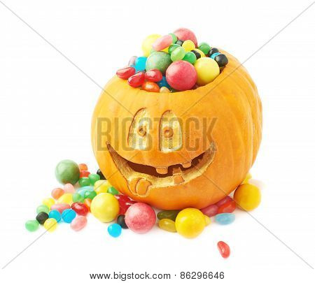 Halloween pumpkin filled with candies