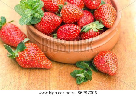 Strawberries in rustic bowl