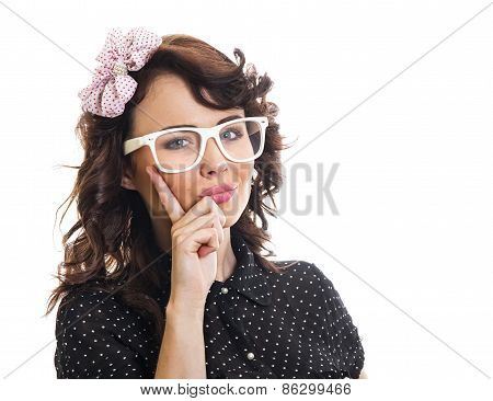 Trendy Woman Holding Finger On Her Face And Wearing Eyeglasses. Young Girl Over White Background
