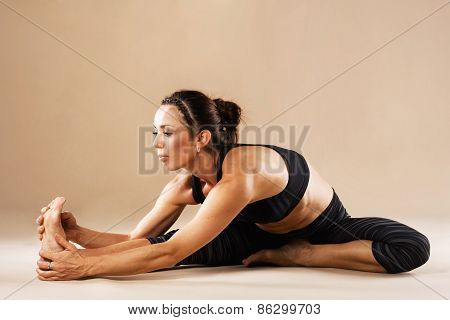 Sporty woman is doing yoga asana