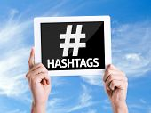 stock photo of hashtag  - Tablet pc with text Hashtags with sky background - JPG