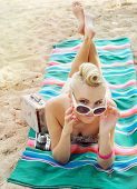 pic of hot-water-bag  - happy cute hot body young woman lying on the beach with colorful details relax concept travel - JPG