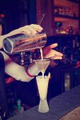 image of bartender  - Bartender is making whisky sour cocktail - JPG