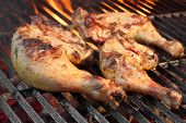 image of flames  - Marinated Chicken Legs Fried On The Hot Flaming BBQ Grill - JPG