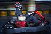 stock photo of karts  - Man karting in formalwear - JPG