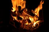 picture of cozy hearth  - Cozy winter fireplace fire with glowing embers - JPG