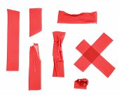 stock photo of insulator  - Multiple pieces of red insulating tape of different shapes - JPG