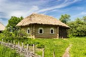foto of farmhouse  - Authentic wooden farmhouse with thatched roof from historical area of Polesie 19th century - JPG