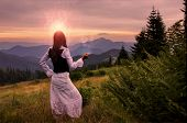 picture of mystical  - Mystic woman in ancient dress alone in a beautiful romantic sunset landscape - JPG