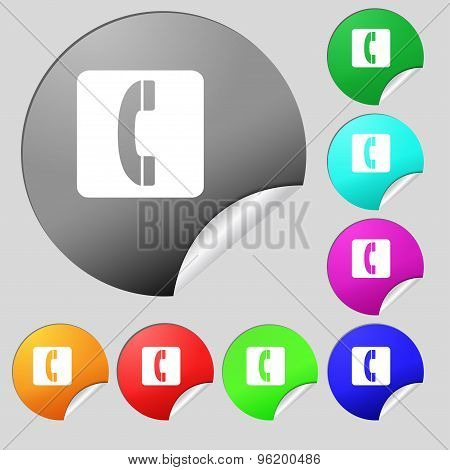Handset Icon Sign. Set Of Eight Multi Colored Round Buttons, Stickers. Vector