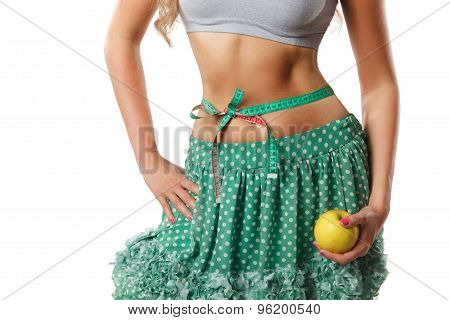 Closeup Of Woman Stomach With Measuring Tape