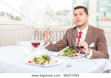Handsome young businessman has an appointment in restaurant
