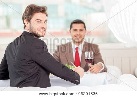 Attractive young businessmen have an appointment in restaurant