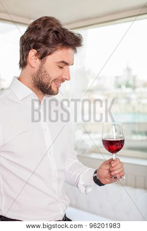 Handsome young man is relaxing with alcohol drink