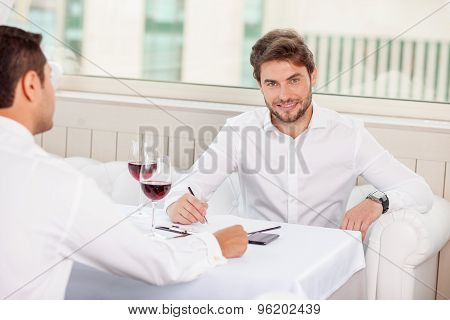 Handsome young businessmen have an appointment in restaurant