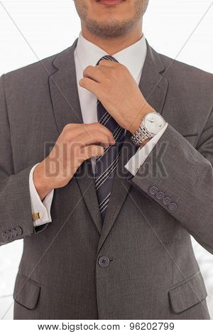 Young successful businessman is preparing for meeting