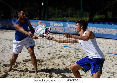 MOSCOW, RUSSIA - JULY 15, 2015: Georgios Martinis (left) and Grigorios Raptis of Greece in action during the ITF Beach Tennis World Team Championship. 28 nations compete in the event this year
