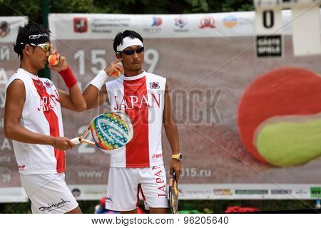 MOSCOW, RUSSIA - JULY 15, 2015: Kotaro Aizawa (right) and Naoaki Yamamoto of Japan in action during the ITF Beach Tennis World Team Championship. 28 nations compete in the event this year