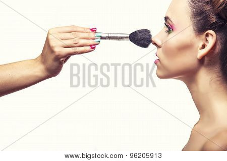 Beautiful Fashion Model Girl Whose Makeup Artist Apply Makeup, Powder And Blush