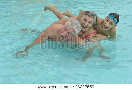 Happy Elderly couple with grandson